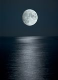 Full moon in black sky stock image
