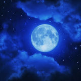Full moon in blue night sky Stock Image