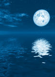 Full moon in calm water. Full moon reflecting in calm water Royalty Free Stock Image