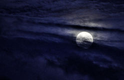 Full Moon. In the clouds royalty free stock photography