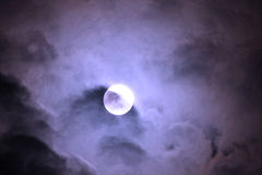 Full moon in clouds Stock Image