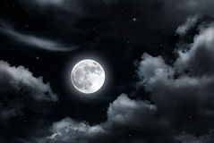 Full moon and clouds Stock Images