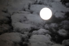 Full moon with clouds over dark black sky Royalty Free Stock Image