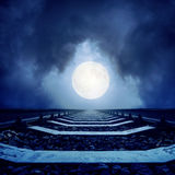 Full moon in clouds and railroad. To horizon Royalty Free Stock Image