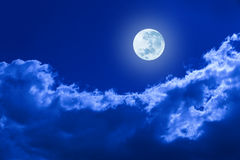 Full Moon Clouds Night Sky. A full moon glowing in a night sky with clouds Royalty Free Stock Images