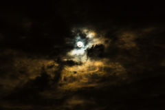 Full moon and clouds on stormy overcast night.  royalty free stock photography