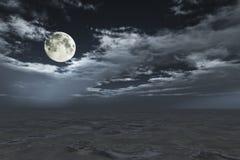 Full moon in cloudscape. Over sand desert Stock Photo
