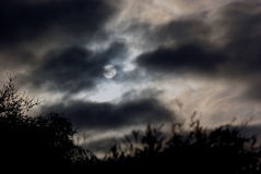 Full-moon cloudy night Royalty Free Stock Image