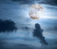 Full moon in a cloudy night Royalty Free Stock Photography