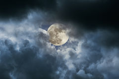 Full moon in a cloudy night. Beautiful full moon in a cloudy night royalty free stock images