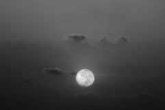 Full moon in a cloudy night Stock Images