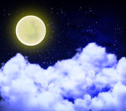 Full moon on a cloudy night sky Royalty Free Stock Image