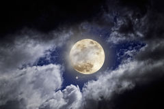 Full moon. In a cloudy night with stars Royalty Free Stock Photo