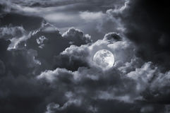Full moon cloudy sky Royalty Free Stock Image