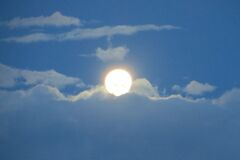 full moon in cloudy sky 4 (daytime) Royalty Free Stock Image
