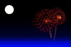 Full moon with colorful fireworks show. Stock Photos