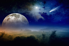 Full moon and comet. Glowing clouds, full moon rise, stars and comet in dark blue sky. Elements of this image furnished by NASA nasa.gov Stock Photos