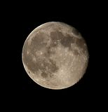 Full moon with craters clearly visible in the dark sky Stock Image