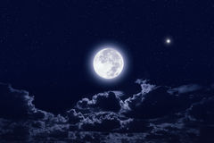 Full moon. In dark night sky with stars and clouds. Elements of this image furnished by NASA Stock Image