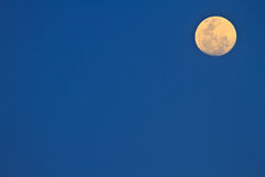Full moon in dark sky Stock Photos