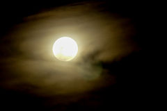 Full moon on dark sky with mist. Black background Stock Photo