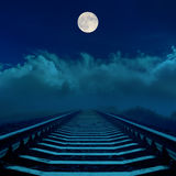 Full moon in dark sky over railroad Stock Photos