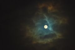 Full moon on dramatic cloudy sky Stock Images