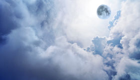 Full moon in dreamy fantasy sky. Wispy white clouds with full moon in distance royalty free stock photo