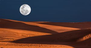 Full Moon and Dunes Stock Photo