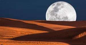 Full Moon and Dunes Royalty Free Stock Images