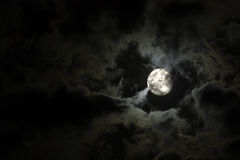 Full moon and eerie white clouds stock photos