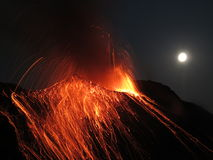 Full moon eruption volcano Stromboli. Volcano erupting with Strombolian eruption in the night with full moon Royalty Free Stock Photos