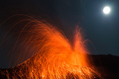 Full moon eruption volcano Stromboli. Volcano erupting with Strombolian eruption in the night with full moon Stock Images