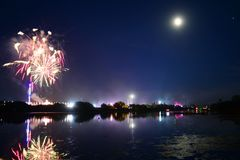 Full Moon, Fireworks and Fun at the Isle of Wight Festival 2108. Fireworks, lights and a near full `strawberry` moon reflect off the River Medina on the last Royalty Free Stock Photography