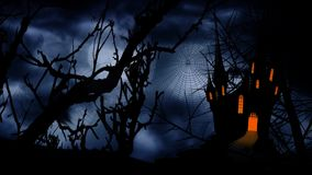 Full Moon Happy Halloween Castle 4K Loop. Features a full moon in an orange sky with a tree and castle silhouette and bats flying and a hand written Happy stock video footage