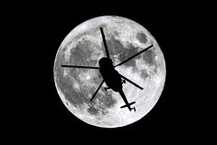Full Moon helicopter silhouette royalty free stock photo
