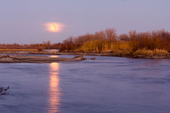 Full Moon on the Horizon Reflecting in the Platte River Water Stock Photography