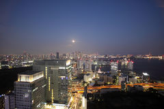 Full moon and light up buildings in Tokyo Stock Images