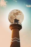 Full moon with lighthouse on the sky, pastel vintage tone Stock Image