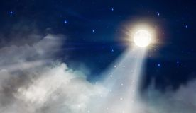Full moon like a lighthouse night sky with big fluffy clouds royalty free stock image