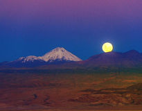 Full-moon in the Moon Valley. Atacama. Full-moon in the Moon Valley. Volcanoes Licancabur and Juriques, west of San Pedro de Atacama, Chile in the Cordillera de Stock Photography
