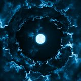 Full moon in mystical midnight sky stars surrounded by dramatic clouds. Dark natural background night sky with moon and clouds. Full moon in the mystical stock images
