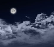 Full moon by night. Glowing full moon at night with cloudscape Stock Image