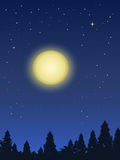 Full Moon night. Big beautiful yellow full moon rising above dark forest in starry night Royalty Free Stock Image
