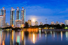 Full moon night in the city. Stock Photos