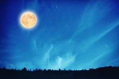 Full moon at night on the dark blue sky Royalty Free Stock Image