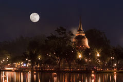 Full moon night above a Thai temple during Loykrat Royalty Free Stock Image