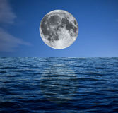 Full moon at night over the sea Stock Photos