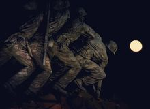 A full moon night photography in IWO memorial in Washington DC. Love this beautiful sculpture my favorite spot in Washington DC yellow royalty free stock image