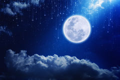 Full moon. In night sky with falling stars and mysterious light from above. Elements of this image furnished by NASA http://visibleearth.nasa.gov Royalty Free Stock Photos